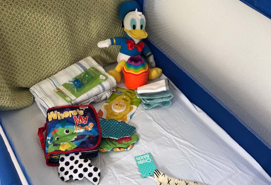 Playpen with baby toys