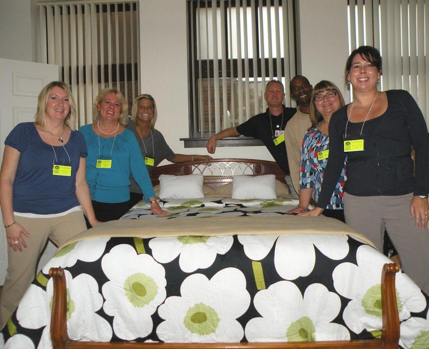 Group of volunteers in apartment