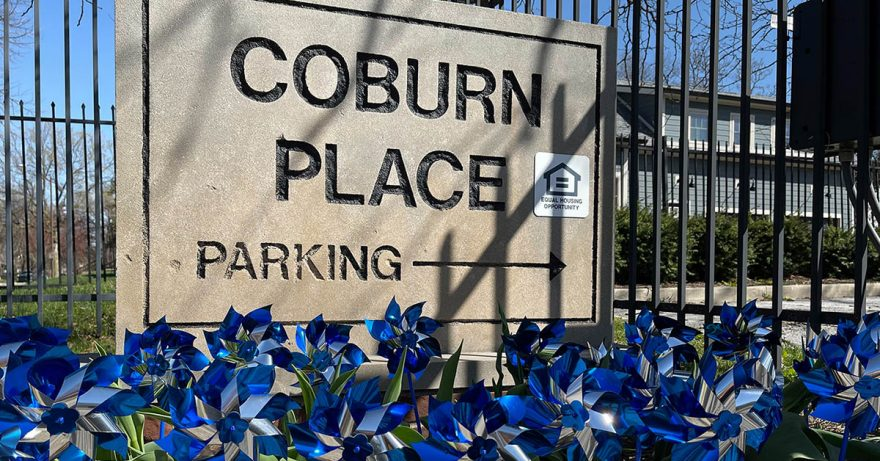 Coburn Place sign decorated with blue pinwheels